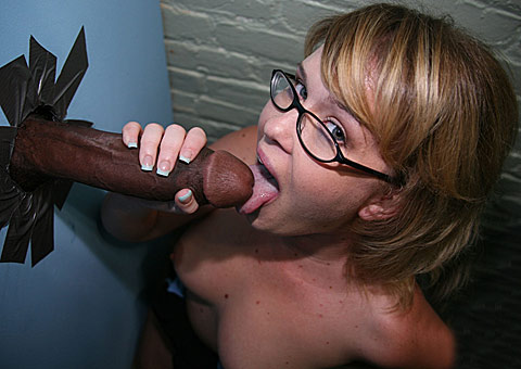 Busty Sasha Knox meets a massive black cock at a glory hole from GloryHole