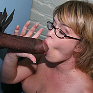 Sasha Knox satisfies a big black cock at a public glory hole from GloryHole