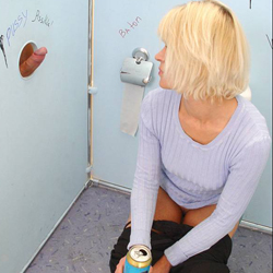 Sexy blonde drinks beer and jizz at a gloryhole